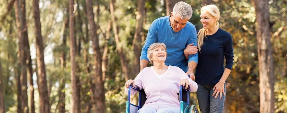 elderly couple and a caregiver
